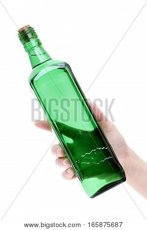 Hand holding green glass bottle isolated on white background