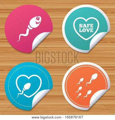 Round stickers or website banners. Sperm icons. Fertilization or insemination signs. Safe love heart symbol. Circle badges with bended corner. Vector