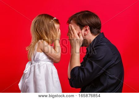 Father and daughter hid eyes. Emotional games with your child. Family fun. The joy of communication. I see nothing.