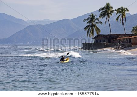 Kayaker on the Mexican Pacific Ocean coast Bay of Banderas