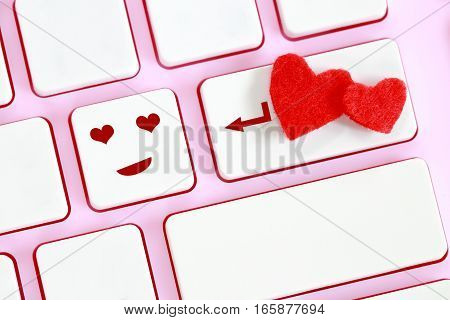Valentine's Day concept heart shape on pink keyboard.