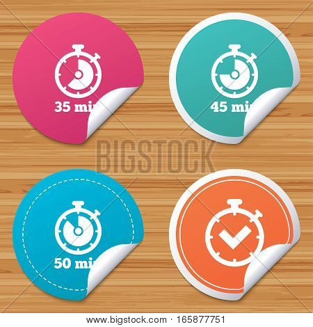 Round stickers or website banners. Timer icons. 35, 45 and 50 minutes stopwatch symbols. Check or Tick mark. Circle badges with bended corner. Vector