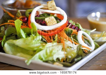 vegetable salad dish with thousand island dressing