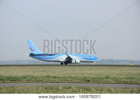March 24th 2015 Amsterdam Schiphol Airport PH-TFC Arke Boeing 737-800 landing on Polderbaan Runway