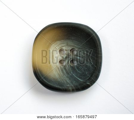 Dark Ornate Plastic Button Isolated On White