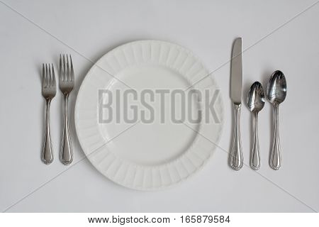 Formal dinner place setting including all utensils