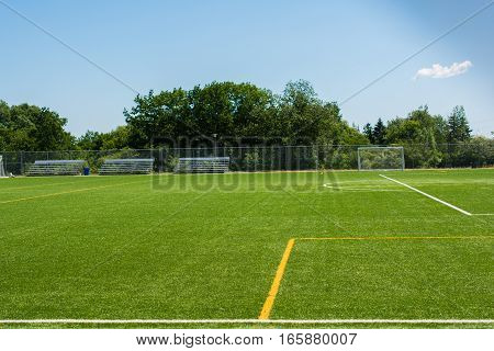 Soccer Field With Bleachers On A Sunny Day