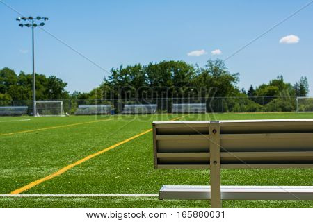 Soccer Field With Bench On A Sunny Day