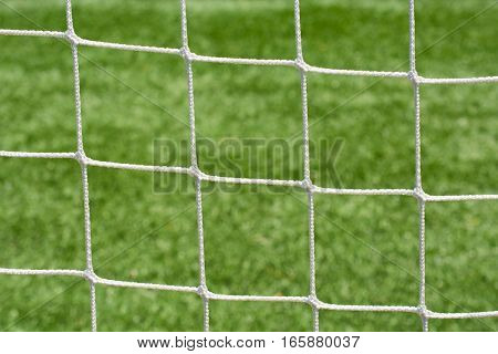 Soccer net mesh of white strings closeup