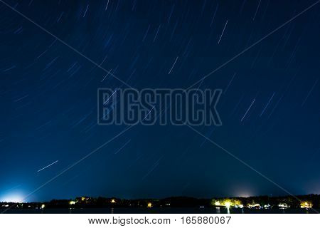 Star Trails Over a Lake at Night