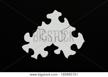 Three Blank Puzzle Pieces On Black Background