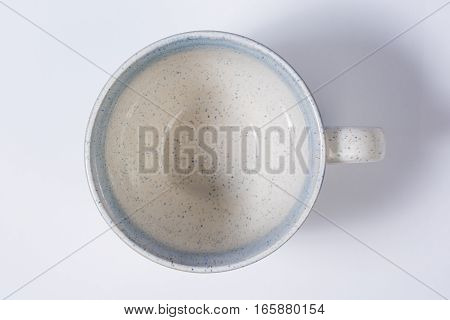 Top Of Speckled Blue Mug Isolated On White