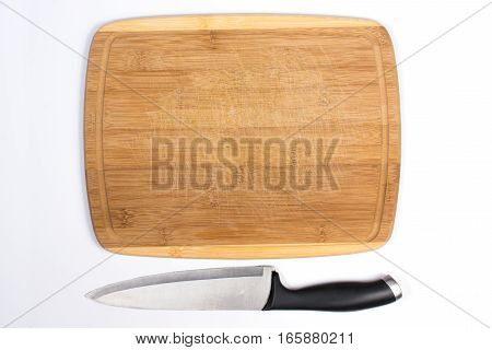 Wooden Cutting Board With Large Knife Beside Isolated On White