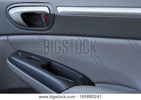 Vehicle Door Panel With Locks And Power Window Buttons Showing