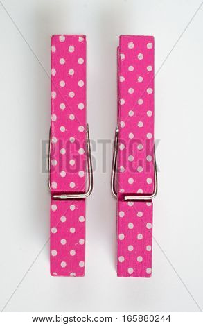 Two Pink Clothes Pins With Fun Patterns Top View