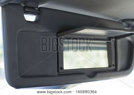 Vehicle Visor Down with Passenger Mirror Open
