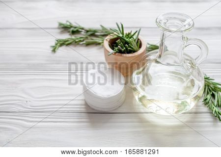 organic cosmetics with extracts of herbs - rosemary on wooden background