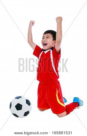 Kneeling young asian soccer player in red uniform screaming and showing arm up gesture. Action of winner or successful people concept studio shot, on white background.