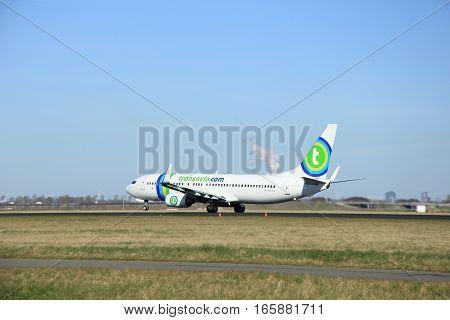 March 22nd 2015 Amsterdam Schiphol Airport PH-HZX Transavia Boeing 737-8K2 take off from Polderbaan Runway
