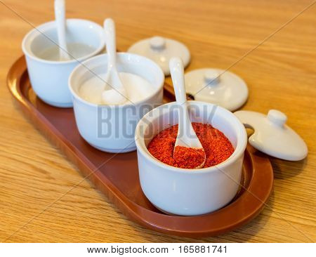 closeup chili powder in white cup on table