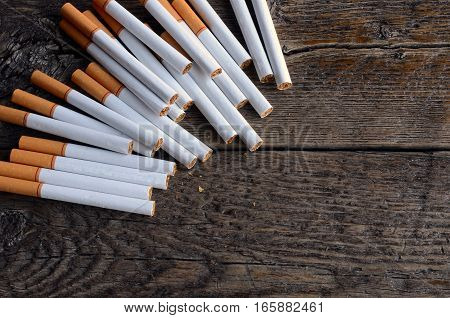 A top view image of several commercially made cigarettes.
