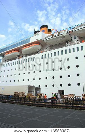 Amsterdam the Netherlands august 2nd 2014 Costa Neo Romantica docked at Amsterdam Passenger Terminal receiving new stock for its next journey