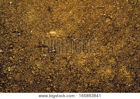 Texture of the soil, soil texture, nature background, yellow soil, yellow abstraction, grunge nature background, ground