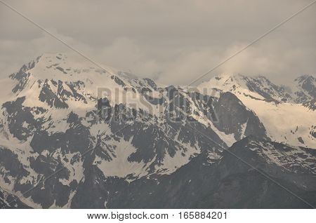 Ushba peak in the Caucasus Mountains. Snowy playing.
