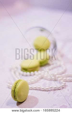 Dessert Macarons Next To Pearls Blur