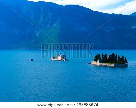 The two small islands at Boka Kotor bay - Montenegro - nature and architecture background