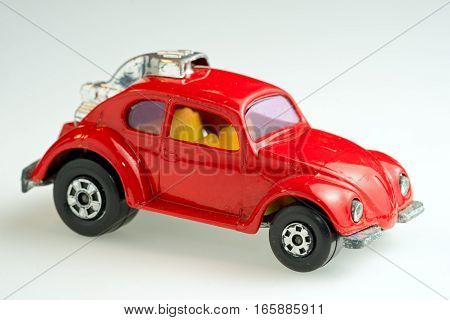 Moscow Russia - January 19 2017: Red toy Volkswagen Super Beetle car on a white background.
