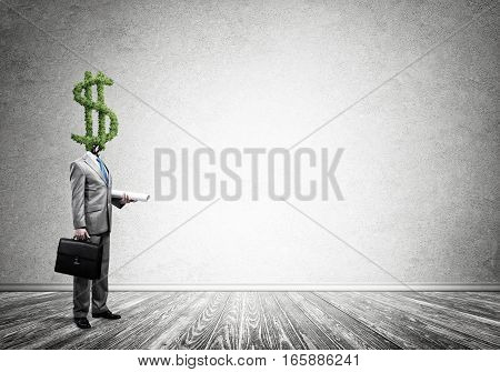 Faceless businessman with dollar green sign instead of head