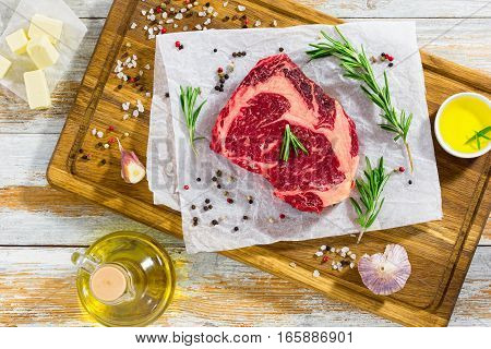 Fresh Meat Steak On White Paper On Chopping Board