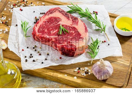 Rib Eye Fresh Meat Steak On Chopping Board