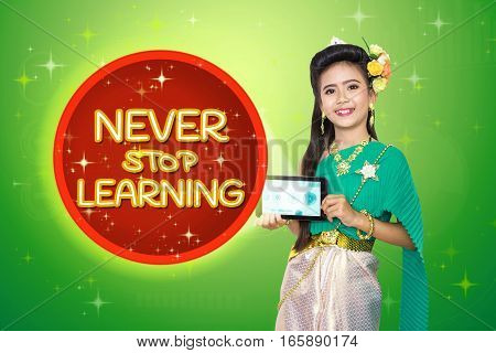 Traditional Thai Girl Child With Never Stop Learning Text.
