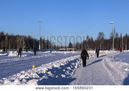 UMEA, SWEDEN ON JANUARY 14. Winter activity around an outdoor sports stadium on January 14, 2017 in Umea, Sweden. Cross country skiing, promenade, walk. Unidentified people. Editorial use.