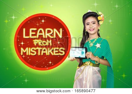Traditional Thai Girl Child With Learn From Mistakes Text.