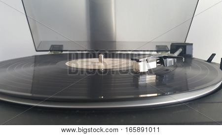 Beautiful vintage record player with vinyl disc