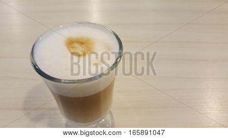 A cup of latte on a table