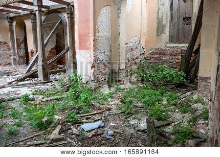 inside of a ruined brick Catholic church