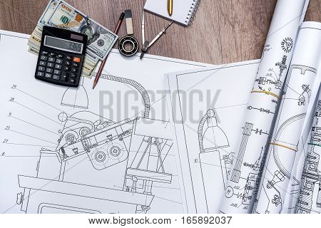 The drawing machine pencil ruler us dollar and compasses
