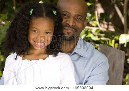 Happy African American father and his daughter.