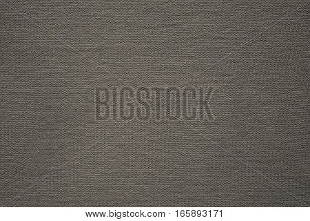 background and texture of beige color of corrugated fabric of jersey of big resolution