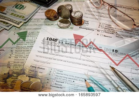 1040 tax form, dollar, pen, coin, glasses