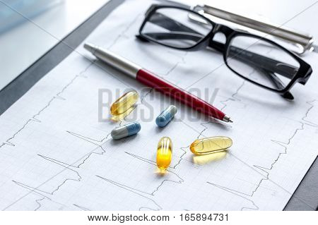 doctors desk with microscope and test tubes.
