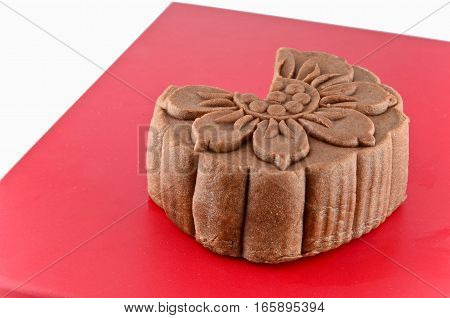 Brown moon cake on the red box