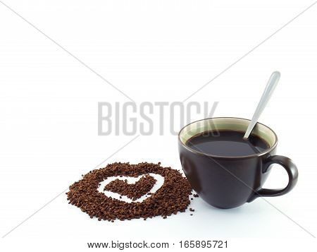 heart shape drawing on instant coffee powder with a black coffee on white background, romantic drink concept