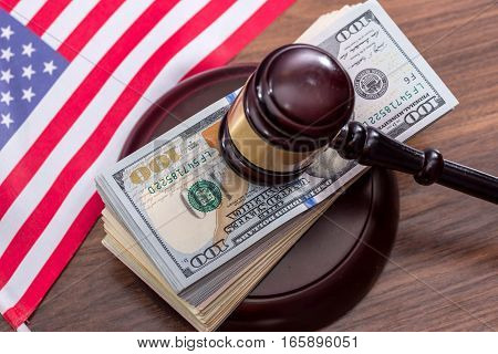 dollar hammer and us flag on desk