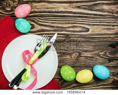 colored Easter eggs on wooden background decoration