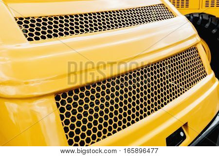 yellow tractor front grille. Front Panel background